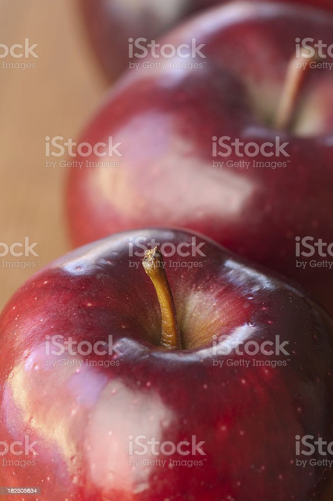 Close up of red apples on a wooden table. stock photo