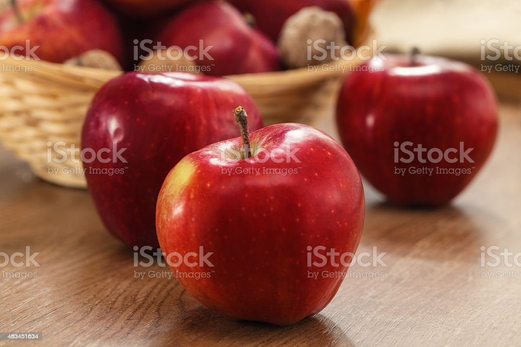 Close up of red apples on wooden background stock photo