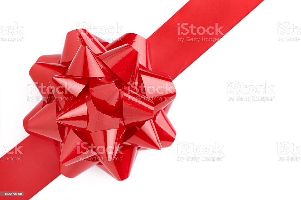 Close up of red gift bow on a white background stock photo