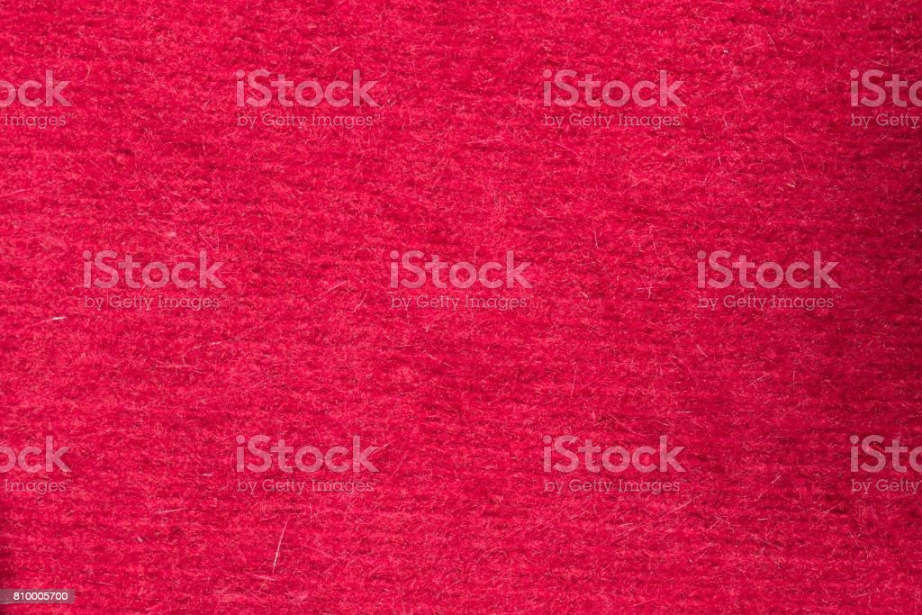 Close up of red handmade knitted fabric stock photo