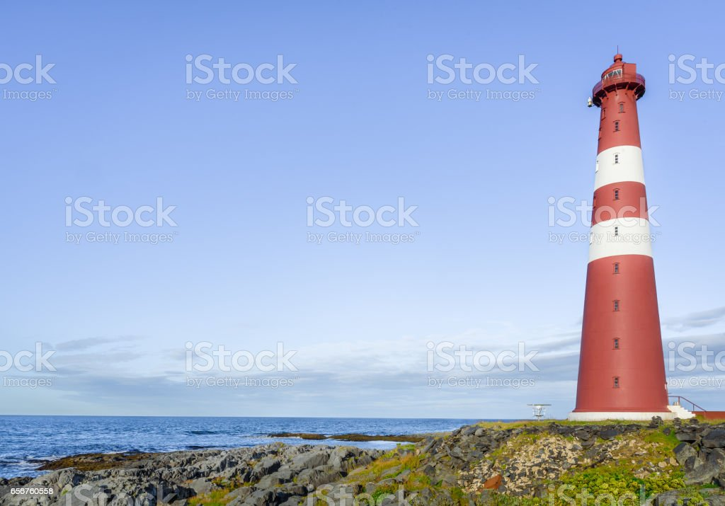 Close up of red lighthouse at Slettnes near Gamvik in Finnmark, Northern Norway stock photo