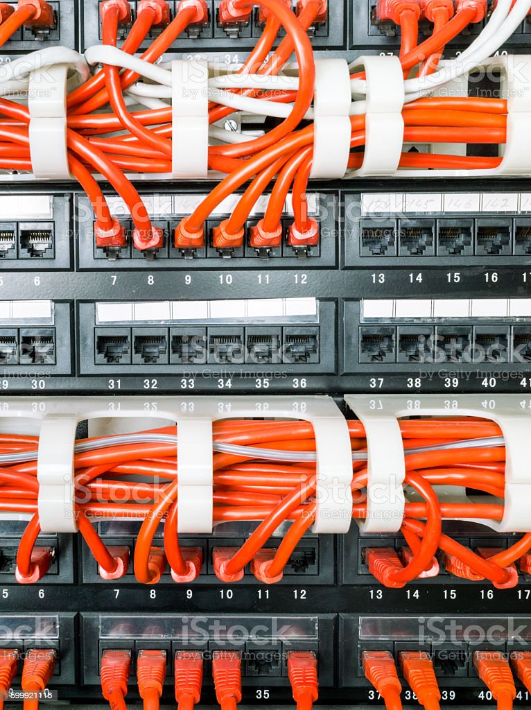 Close up of red network cables connected to switch stock photo
