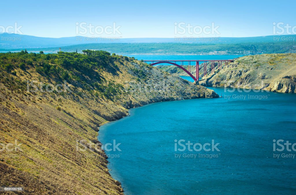 Close up of red steel Maslenica Bridge in the distance stock photo