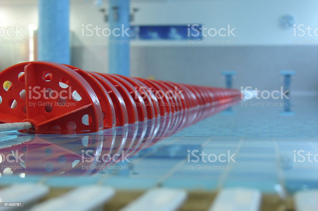 Close up of red swimming pool lane line stock photo