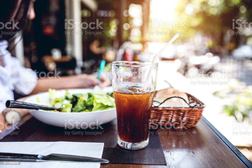 Close up of restaurant table with a soda drink stock photo