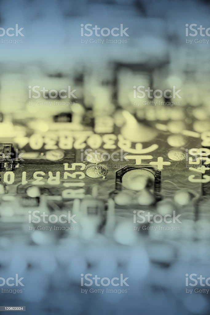 Close up of retro electronic circuit board, toned. stock photo