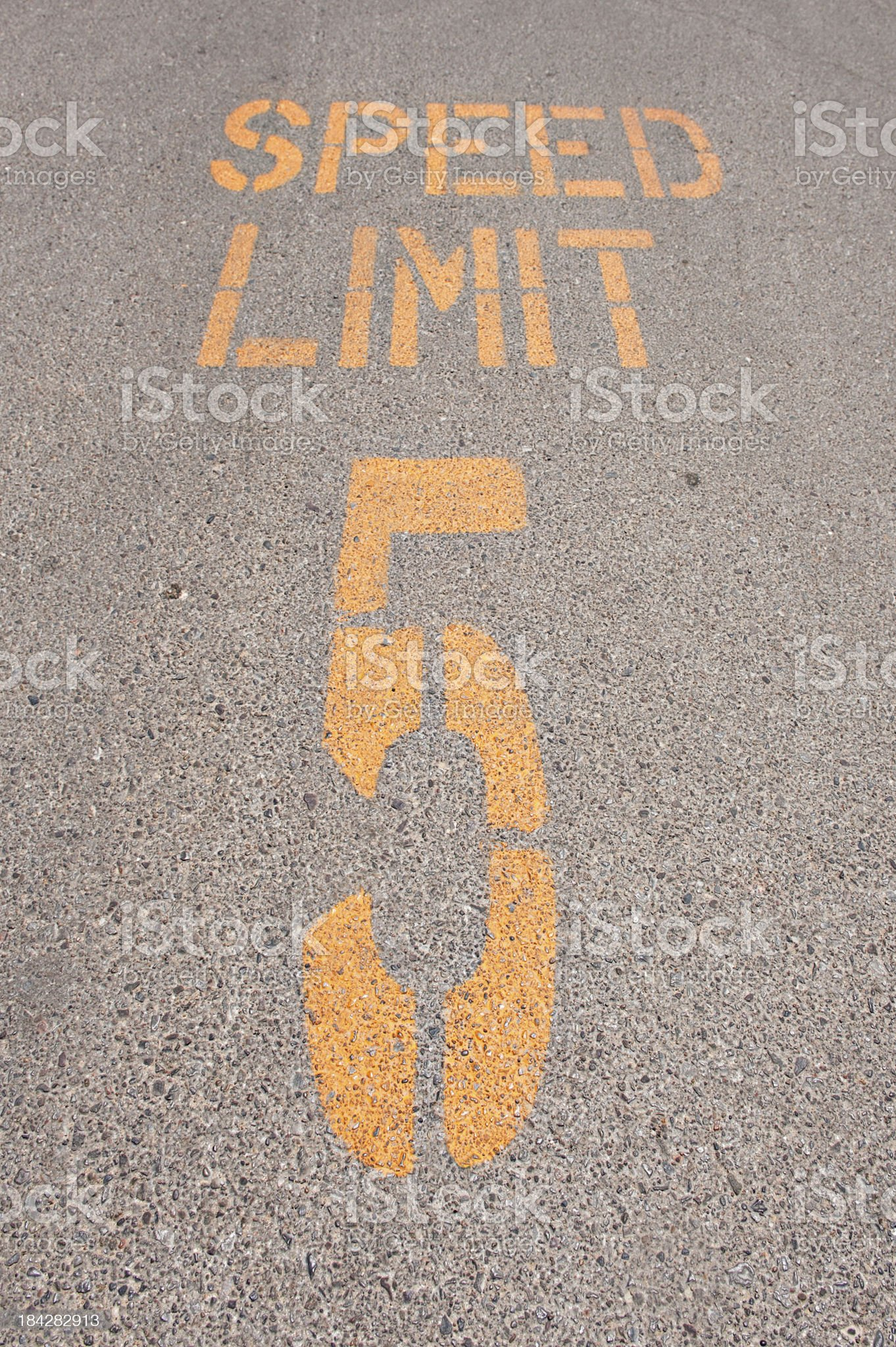 Close Up of Road Surface with Speed Limit Warning royalty-free stock photo