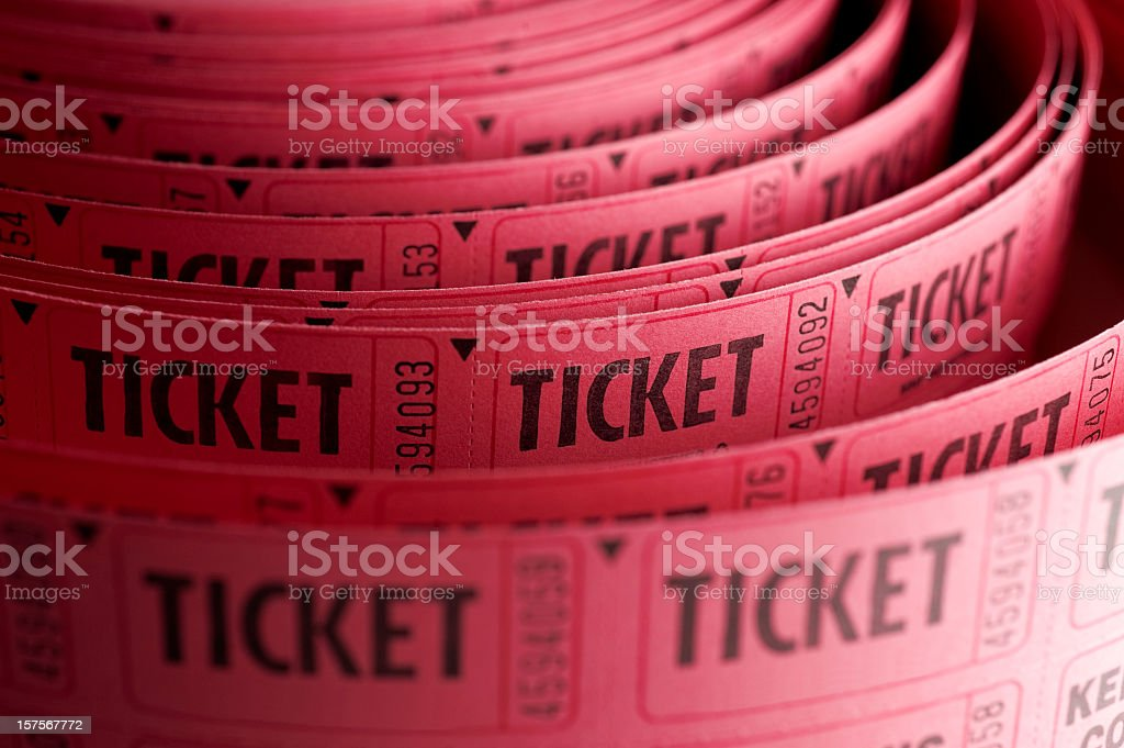 Close up of roll of pink ticket stubs stock photo