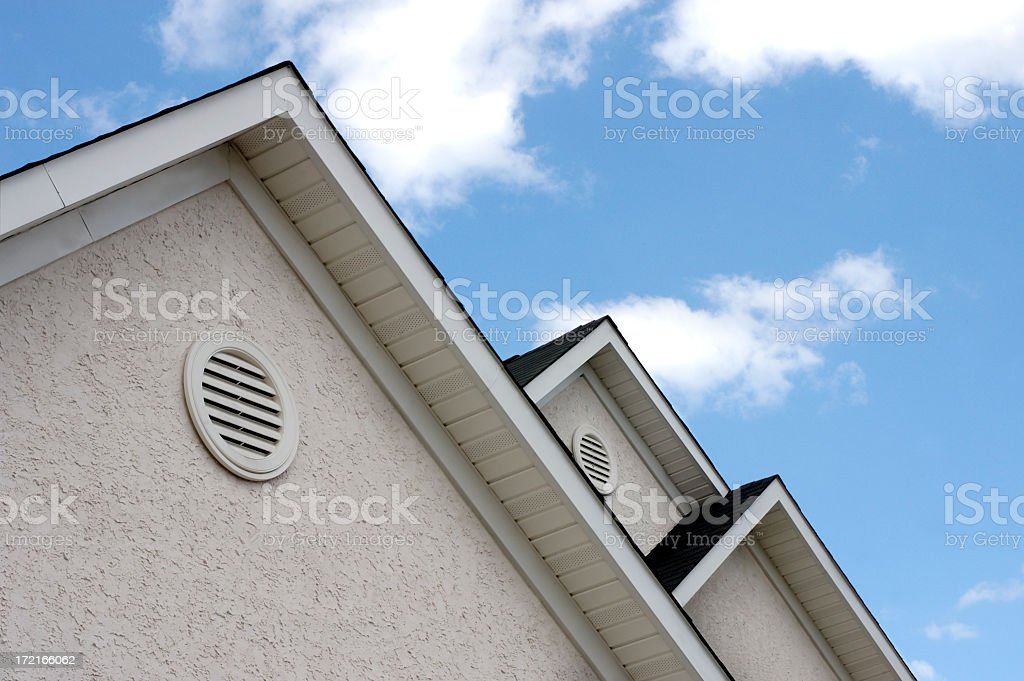 Close up of roof peaks against blue sky royalty-free stock photo