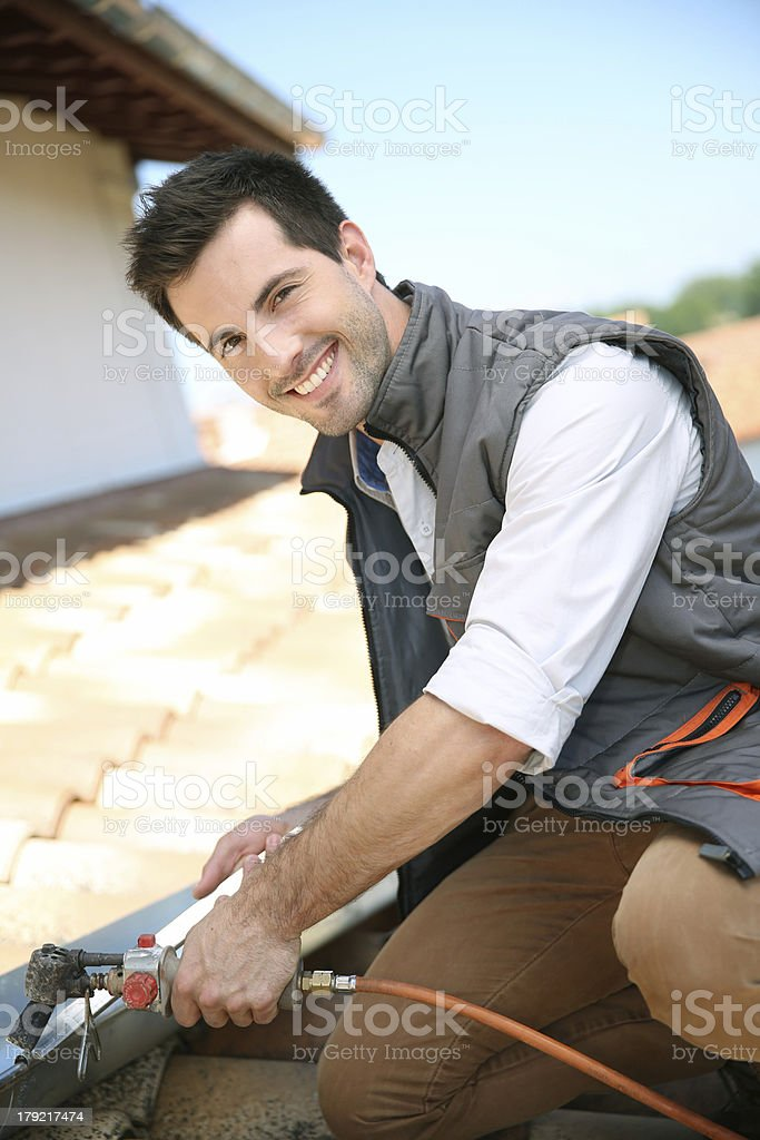 Close up of roofer working stock photo