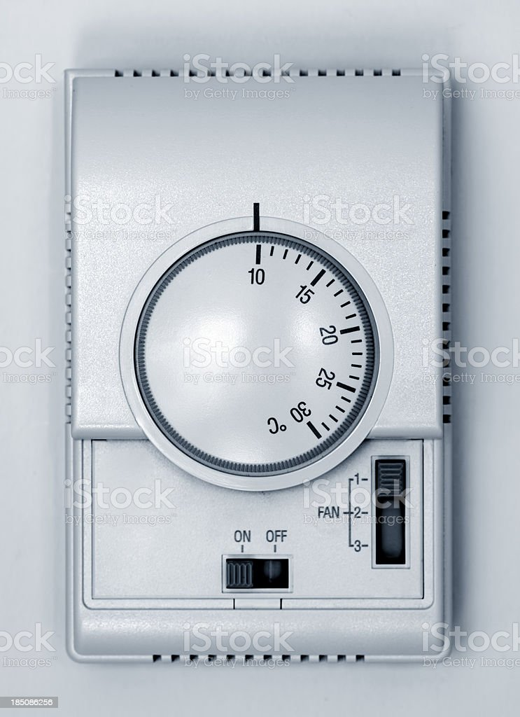 Close up of room thermostat dial stock photo