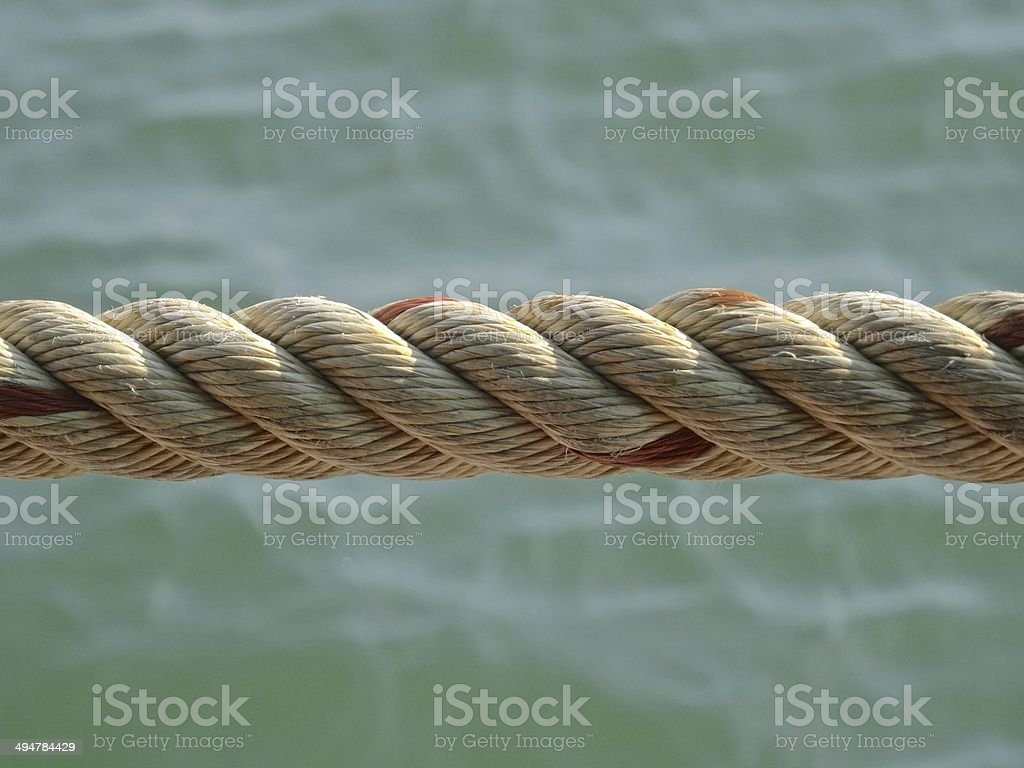 Close up of rope against a background of the sea royalty-free stock photo