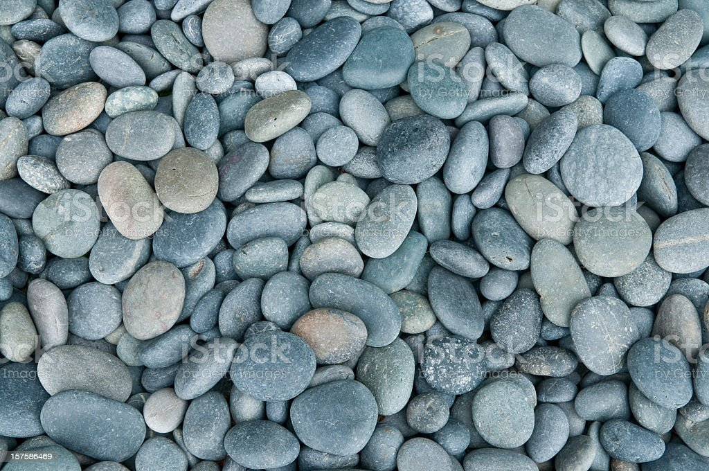 Close up of rounded grey river rocks stock photo