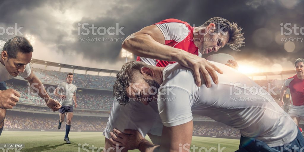 Close Up of Rugby Player Tackled Hard During Match stock photo