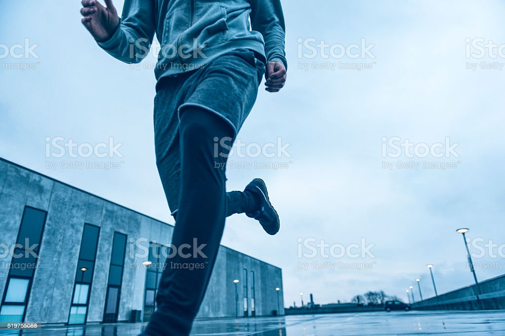 Close up of runner who runs outside in cold weather stock photo