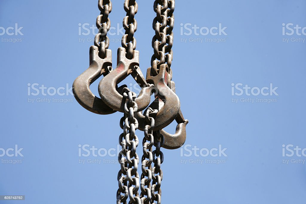 Close up of rusted hanging chain and blue sky stock photo