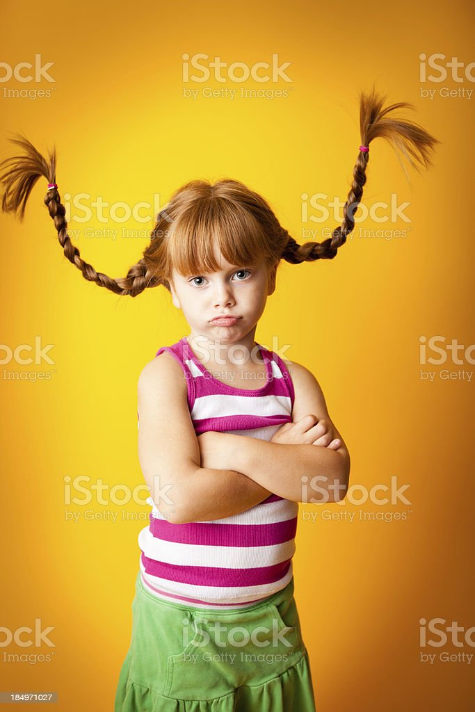 Close up of Sad/Frustrated, Red-Haired Girl with Upward Braids royalty-free stock photo