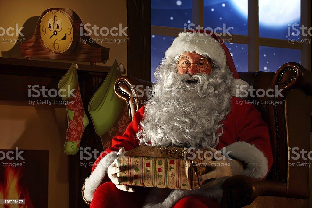 close up of Santa holding a christmas gift royalty-free stock photo