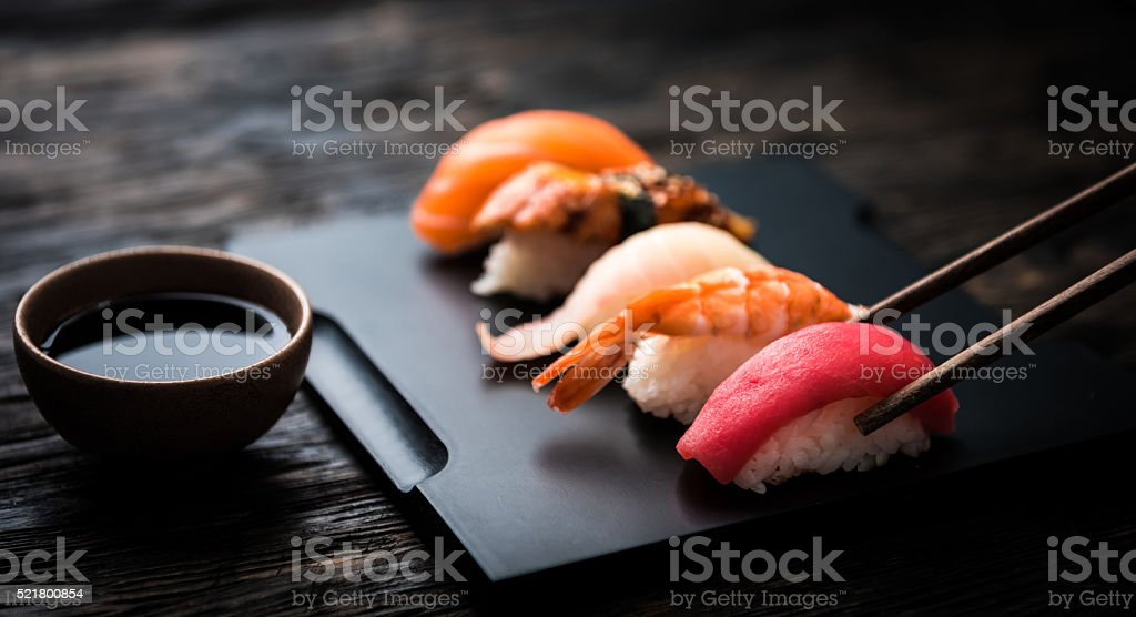 close up of sashimi sushi set with chopsticks and soy stock photo