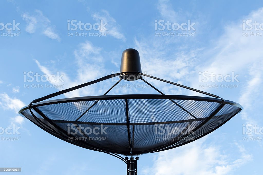 close up of satellite dish in blue sky stock photo