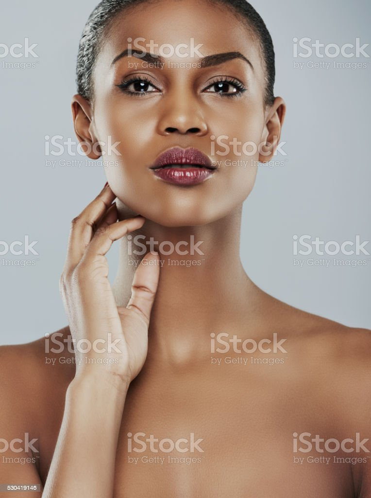 Close up of seductive woman with hand on neck stock photo