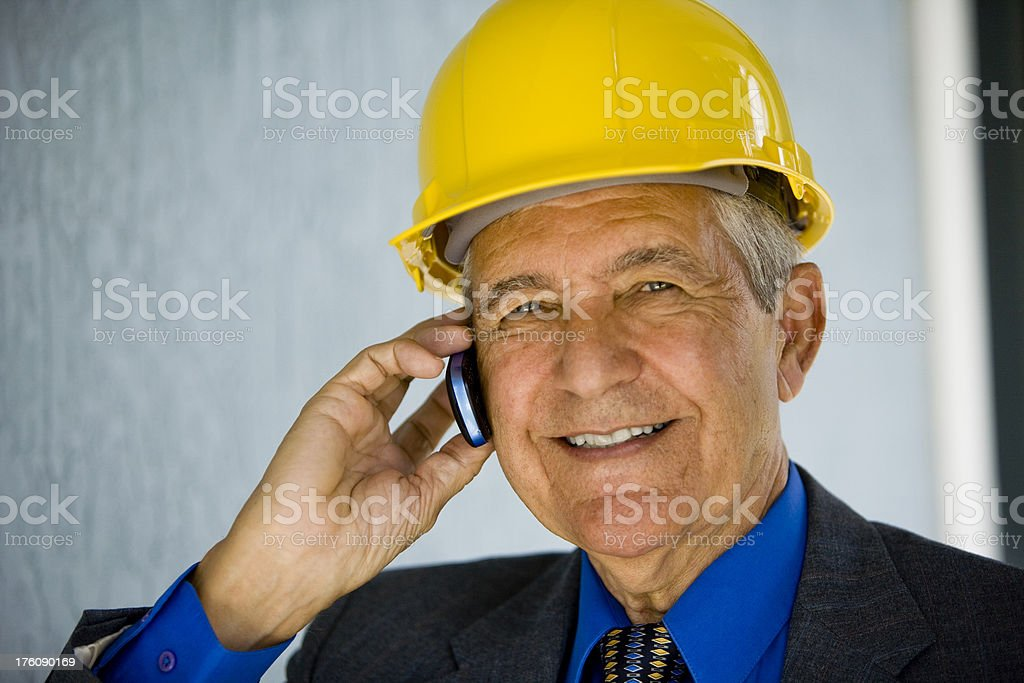 Close up of senior businessman wearing hardhat royalty-free stock photo