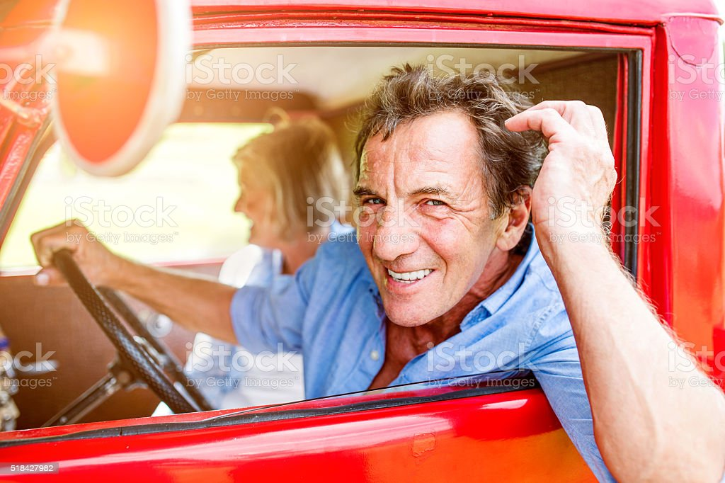Close up of senior couple inside a pickup truck stock photo