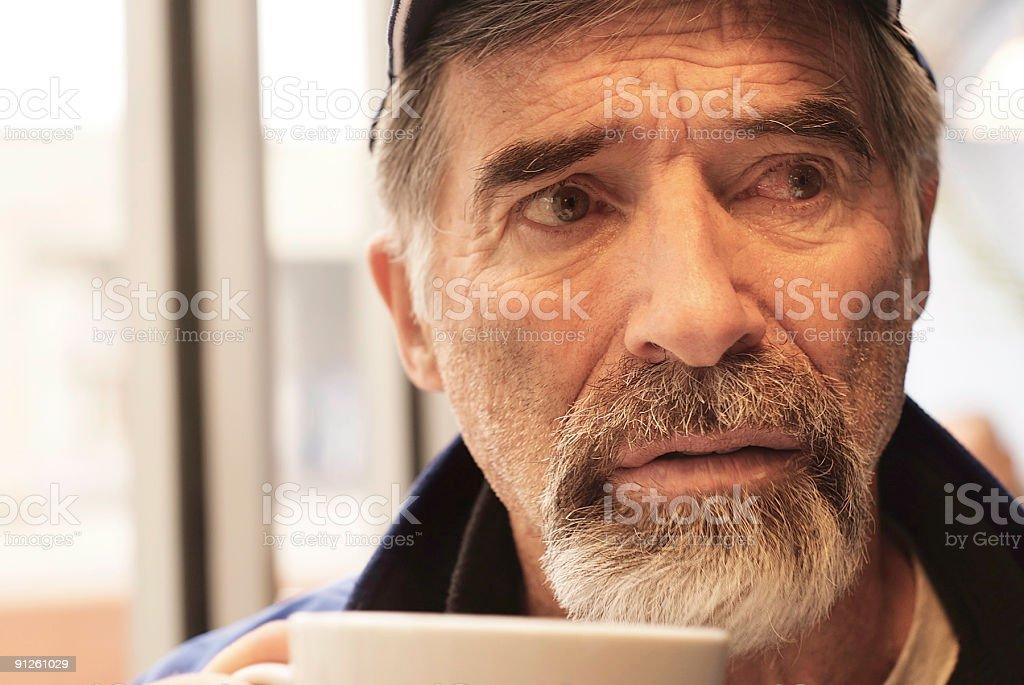 close up of senior man looking pensive royalty-free stock photo