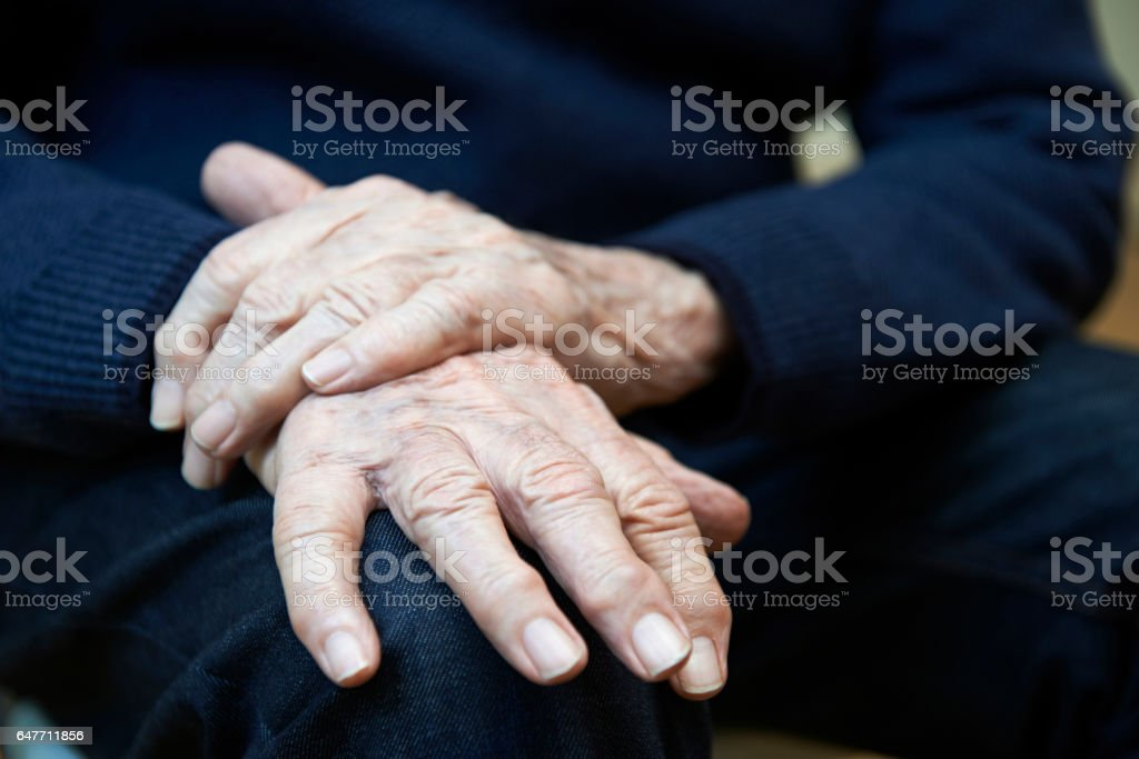 Close Up Of Senior Man Suffering With Parkinsons Diesease stock photo