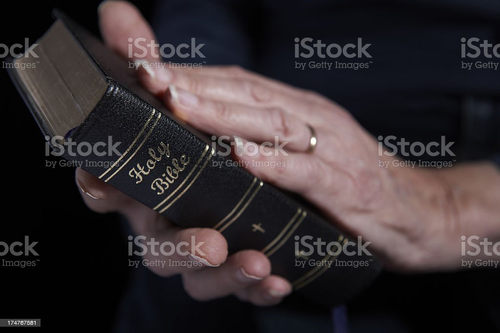 Close Up Of Senior Woman Holding Bible royalty-free stock photo