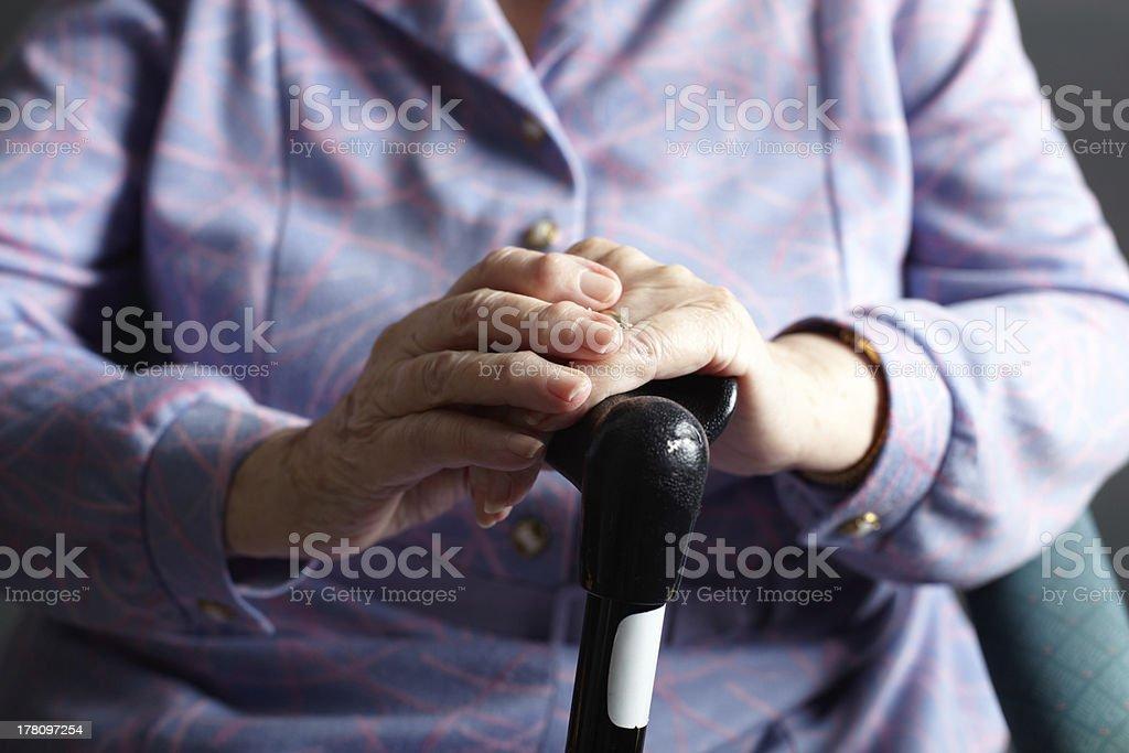 Close Up Of Senior Woman Holding Walking Stick stock photo