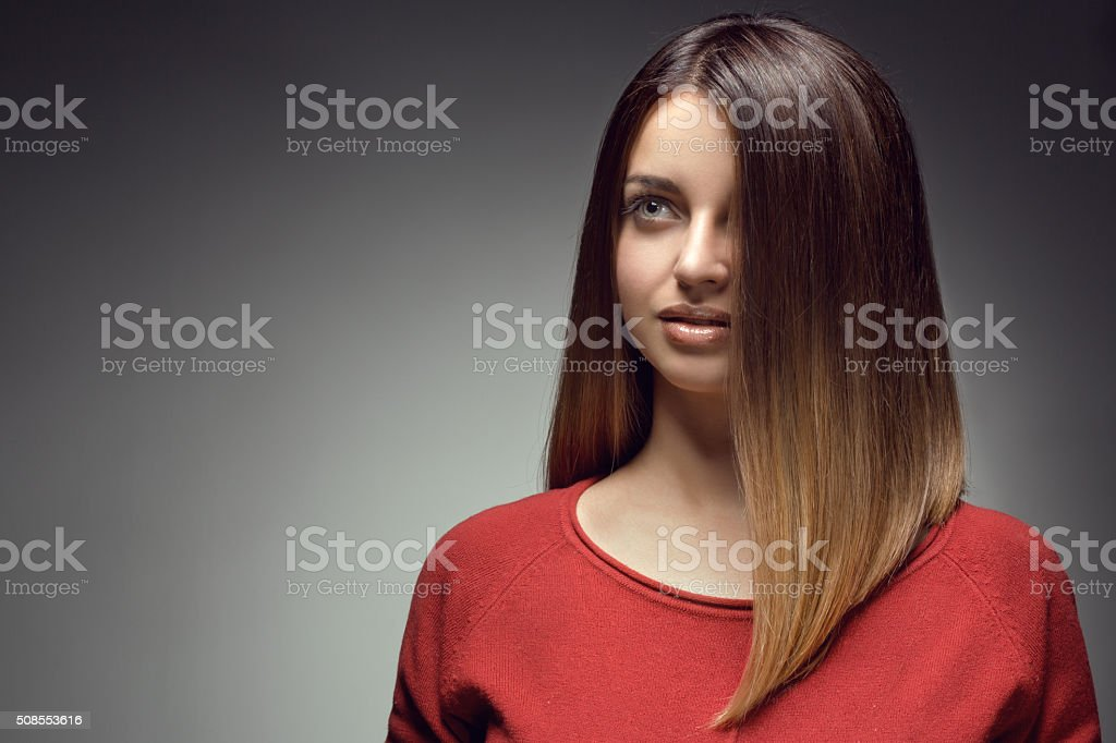 close up of sensual brunette with long straight hair stock photo