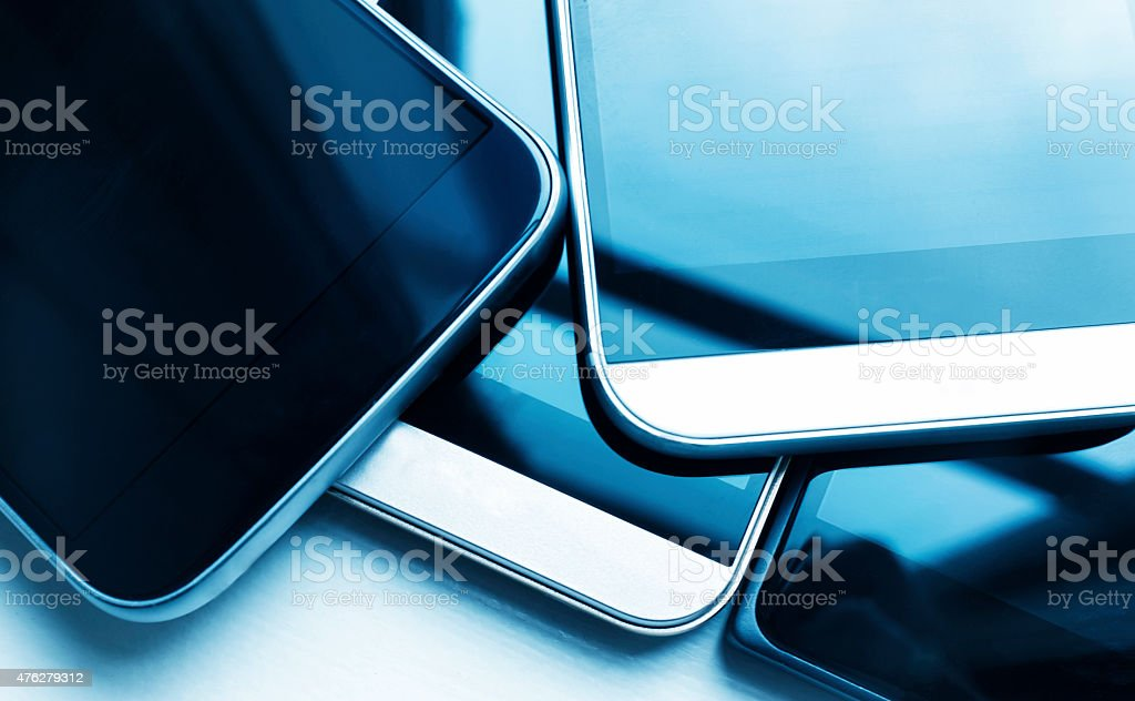 Close up of serveral new smart phones in a stack stock photo