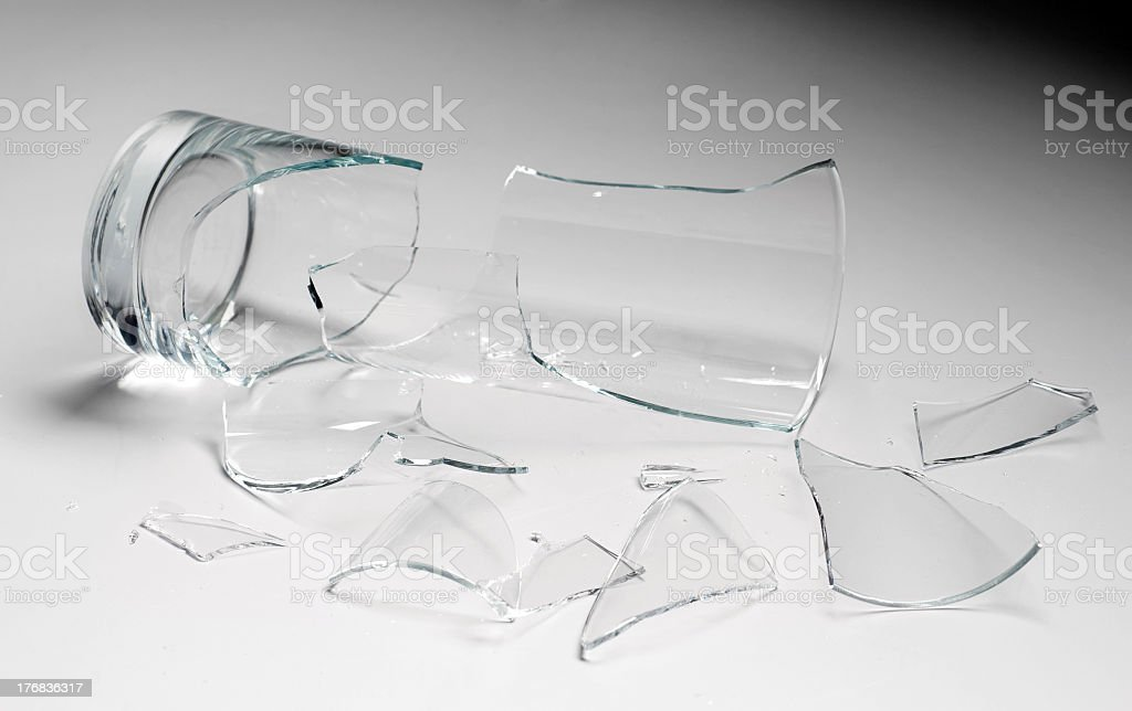 Close up of shattered glass pieces of a glass stock photo