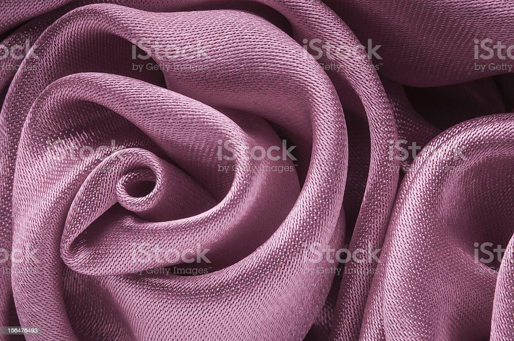Close up of shiny light purple fabric flower. royalty-free stock photo