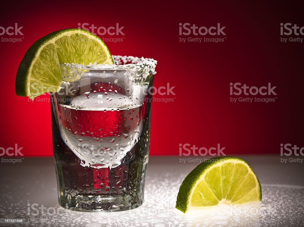 Close up Of Shot Glass and Limes stock photo