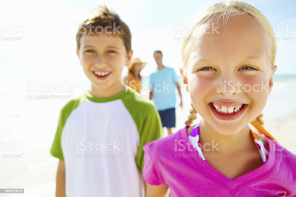 Close up of siblings on the beach royalty-free stock photo
