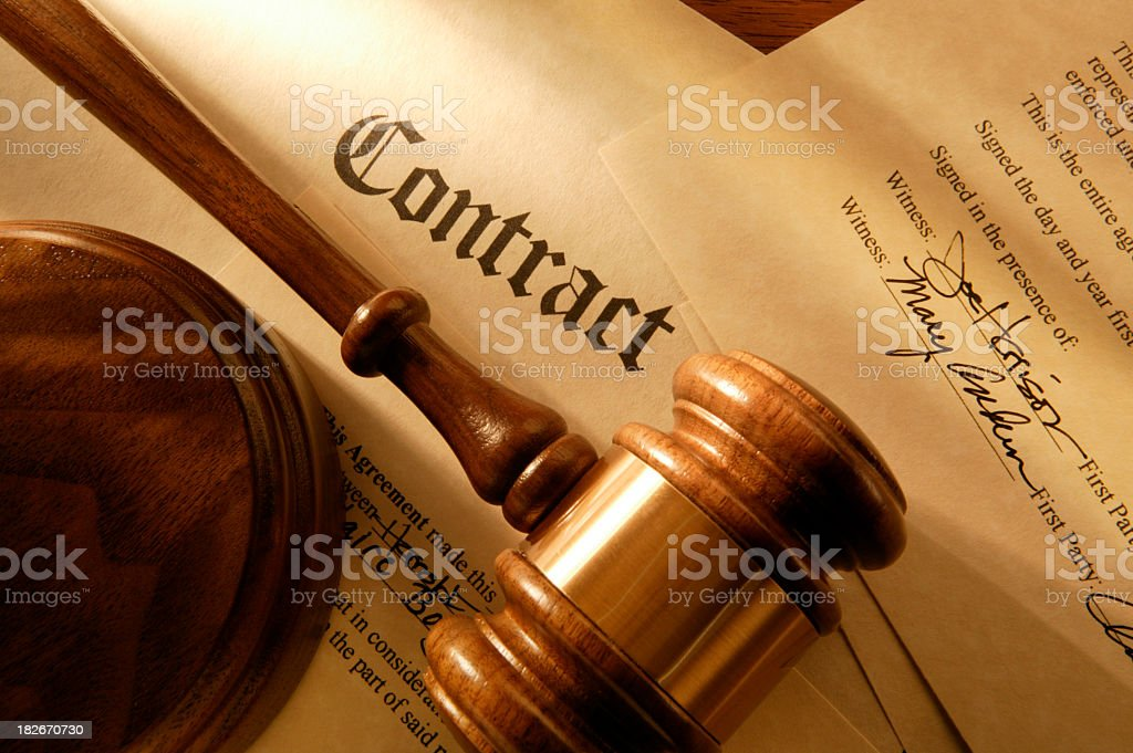 Close up of signed contract with gavel and sound block stock photo