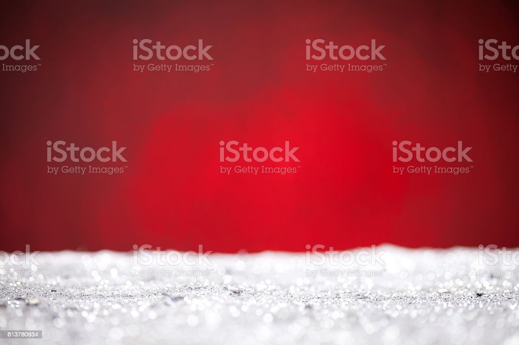 Close up of silver glitter with red background stock photo