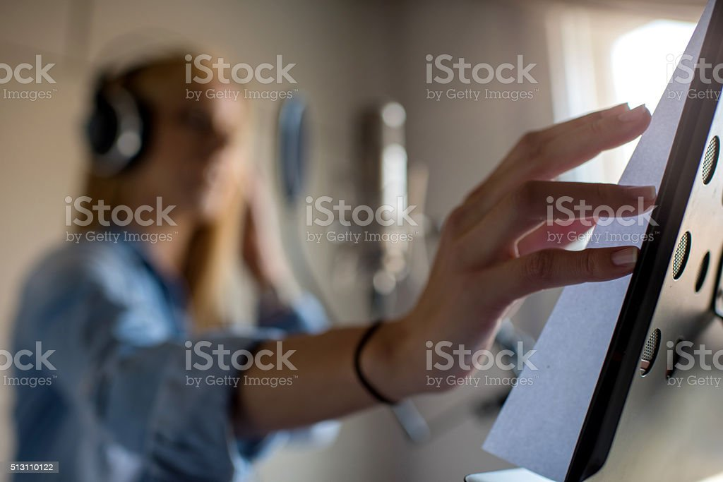 Close up of singer's hand on music stand. stock photo