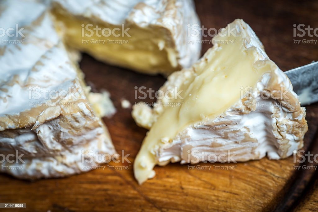 Close up of slice of  camembert cheese stock photo