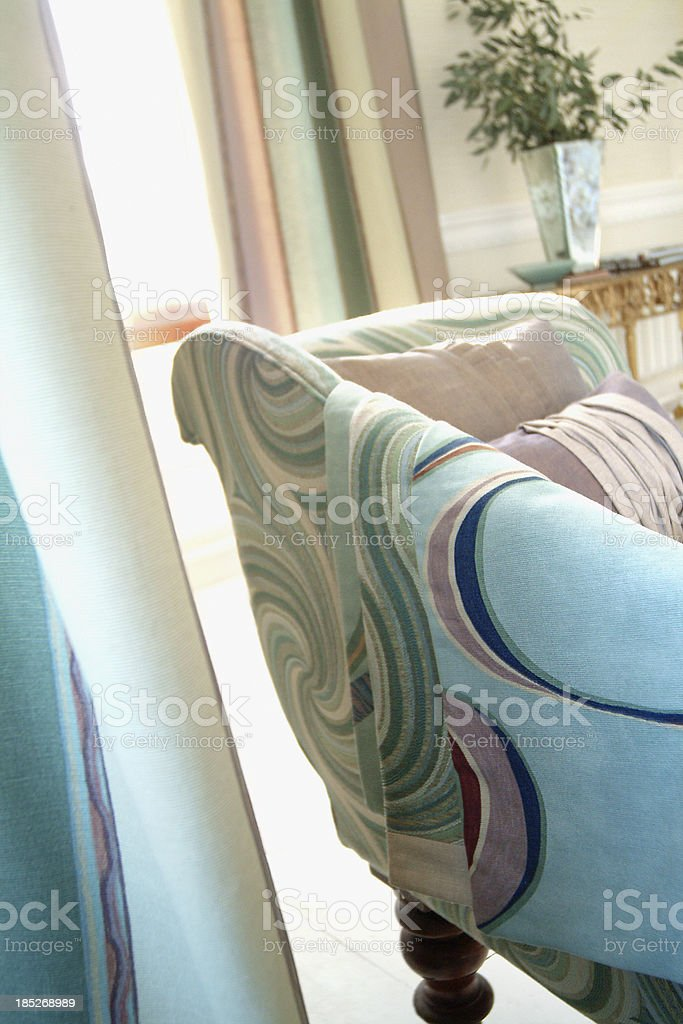 Close up of small formal sofa In Window with cushions royalty-free stock photo