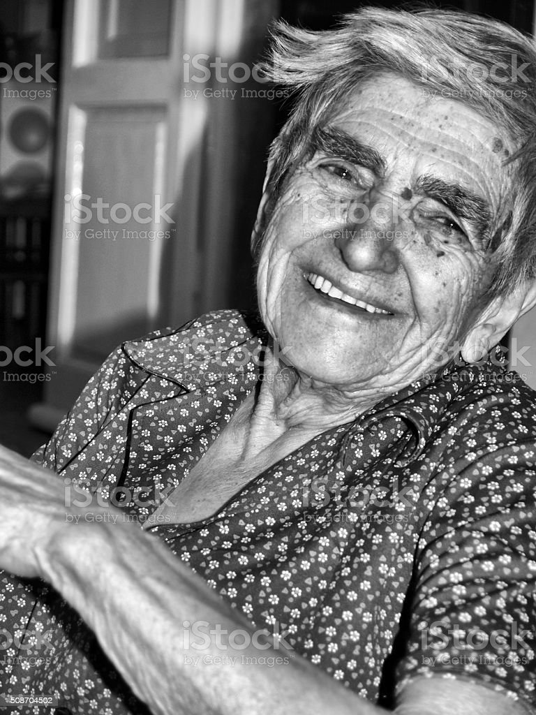 Close up of smiling 100 year old italian woman. stock photo