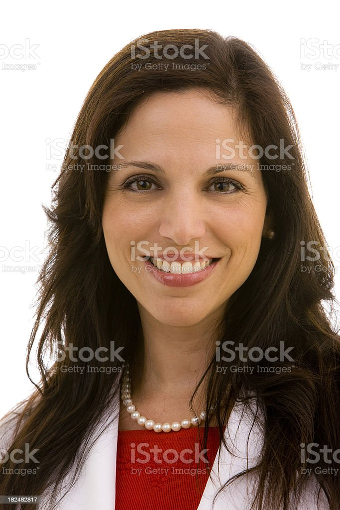 Close up of smiling female wearing lab coat stock photo