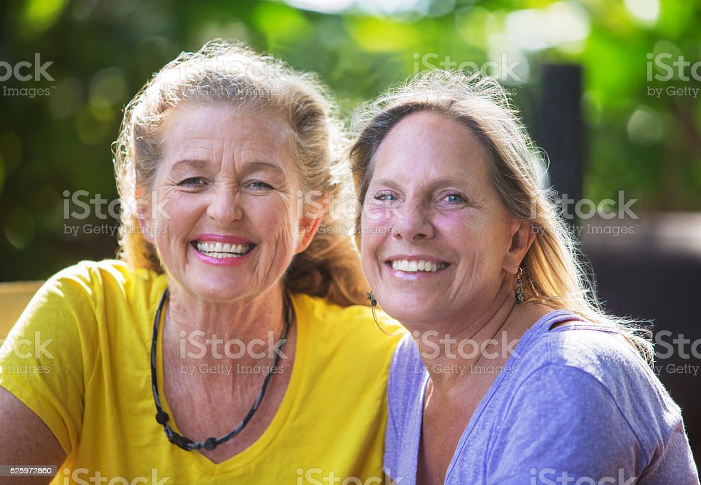 Close Up of Smiling Friends stock photo