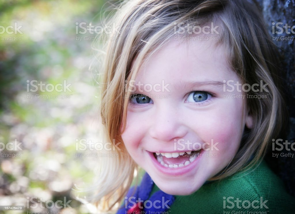 Close up of smiling little girl stock photo
