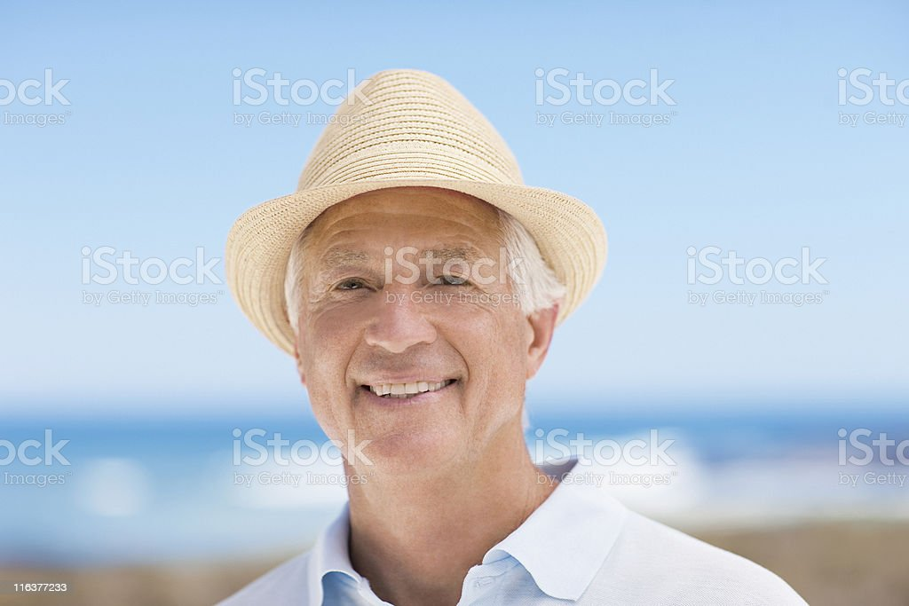 Close up of smiling senior man in hat royalty-free stock photo