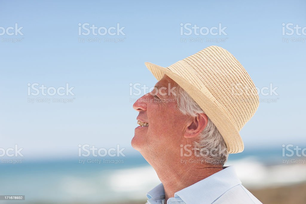 Close up of smiling senior man in hat stock photo