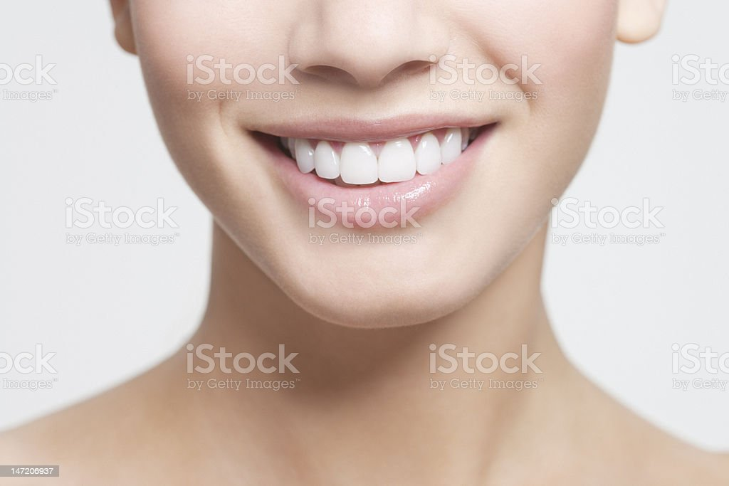 Close up of smiling woman's mouth stock photo