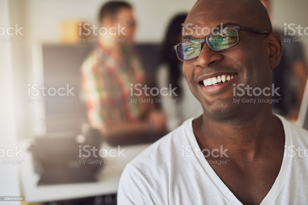 Close up of smiling worker in white shirt stock photo